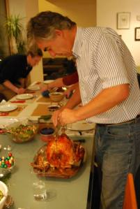"""Dad carving a Turkey (one of two) at last year's """"Turkey Day"""" celebrations in Germany (28.12.13)"""