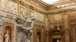 A 'classical' room, with a statue of Hades capturing Persephone