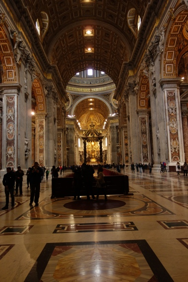 Long, straight vertical lines towards the centre of the Basilica and upwards.